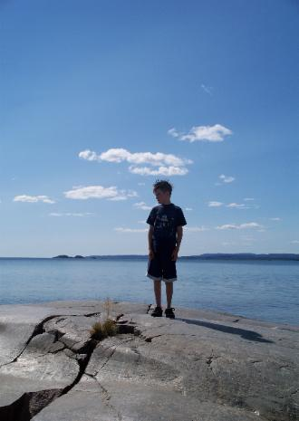 Jordan Nelson on the shore of Lake Superior